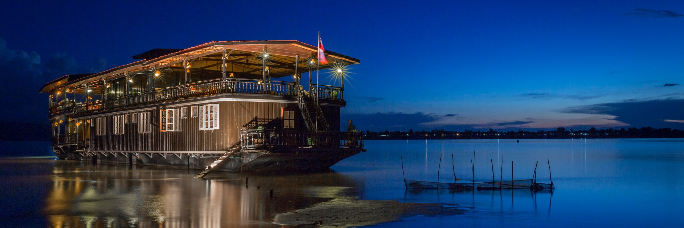 The Vat Phou boat, a floating hotel cruising on the Mekong River, Southern Laos